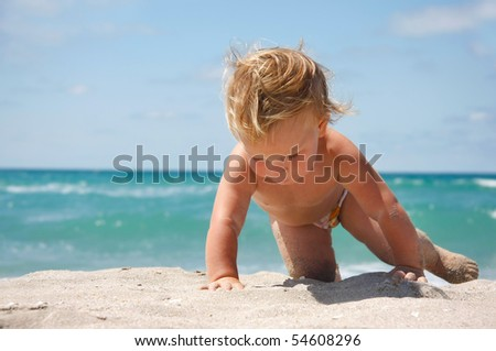close up of baby on sand beach