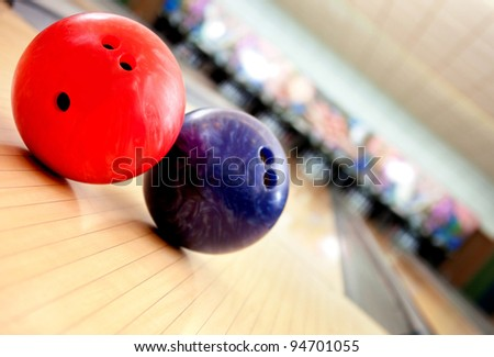Close-up of balls in an bowling alley - stock photo