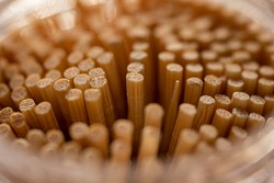 Close up of bamboo toothpicks. Blurry, clean background