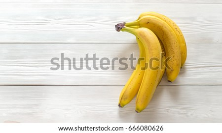 close-up of bananas on white wooden boards