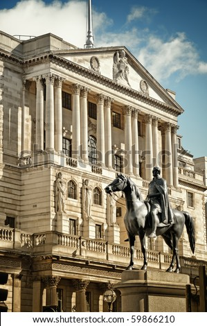 Close-up of Bank Of England`s facade with the statue of Duke of Wellington Statue (created by Francis Chantrey). City of London, England.