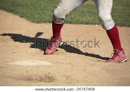 Close up of baseball batter's legs at home plate - stock photo