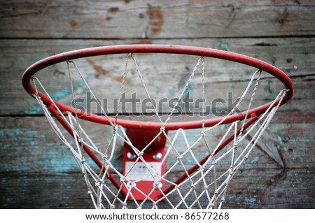 close-up of basketball hoop against weathered wooden wall,  sport object