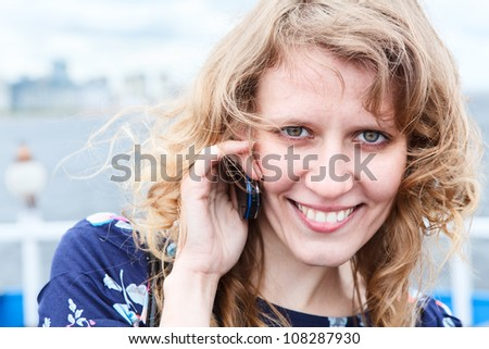 Close up of beautiful Caucasian woman with mobile phone. Copyspace
