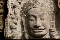 Close up of beautiful stone Buddha statue in the Angkor Wat building temple in Siem Reap, Cambodia