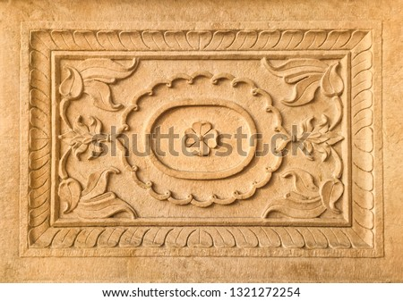 Close up of beautiful stone carved rectangular decorative frame. Decoration details of an old, historic Indian building.