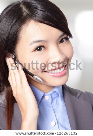 close up of beautiful woman customer support operator with headset and smiling at office, asian woman