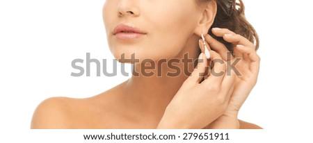 close-up of beautiful woman wearing shiny diamond earrings #279651911