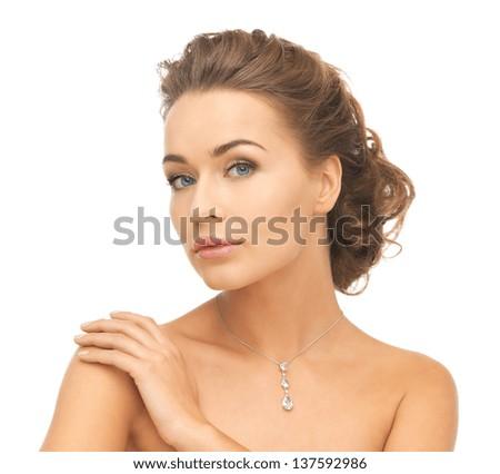 close-up of beautiful woman wearing shiny diamond necklace