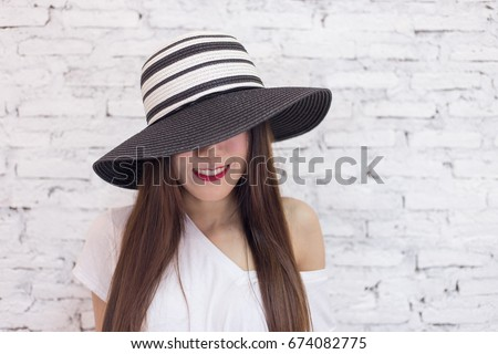 e3abb26ddf1 Close up of Beautiful woman wearing vintage hat cover her face showing only  sexy lips standing