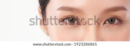 close up of beauty asia woman eye on white background.
