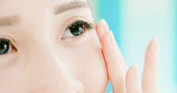 close up of beauty asia woman touch her beautiful health eye