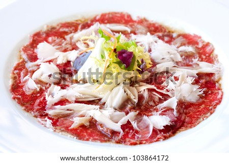 Close up of beef carpaccio with parmesan cheese flocks.