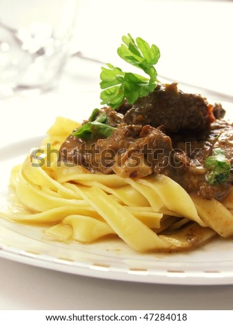 close-up of beef stroganoff on the white plate
