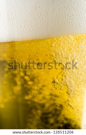 Close up of beer and foam