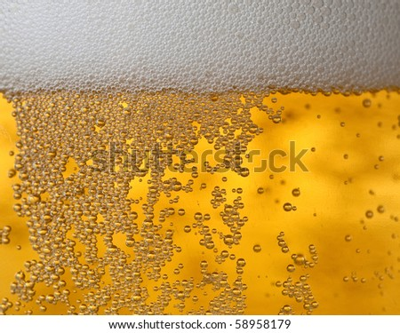 close-up of beer bubbles - stock photo