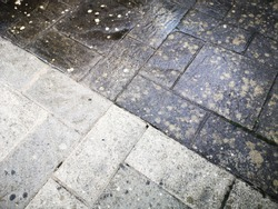 Close up of before and after patio cleaning with high pressure water jet washer. Full frame - background with copy space.