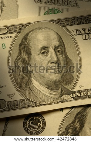 Close-up of Benjamin Franklin on the $100 bill, dramatically lit.