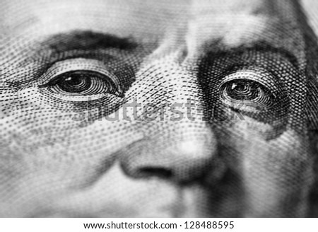 close up of Benjamin Franklin stare on one hundred dollars banknote