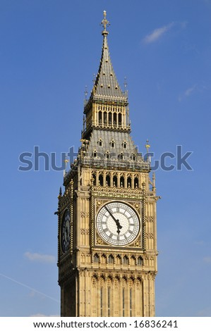 Close-up of Big Ben, the Great Clock of Westminster, designed by Augustus Pugin. The surround of the dials is heavily gilded and so reflects the falling sun beautifully