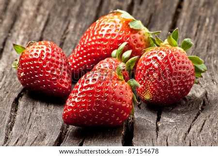 close up of big strawberry on wood - stock photo