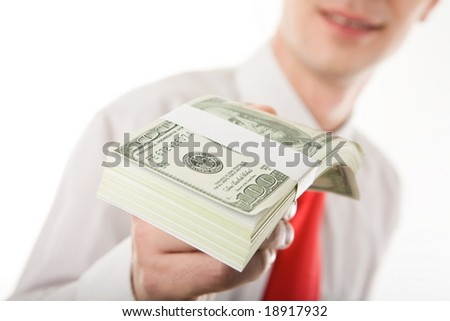 Close-up of bills of American hundred-dollar banknotes being held by man
