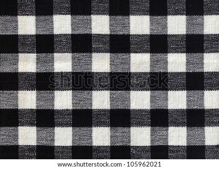 Close-up of black and white gingham checked fabric background