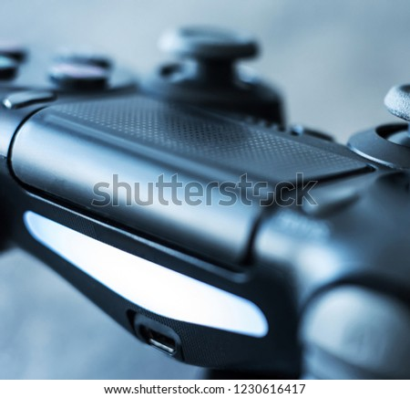 Close-up of black authentic dualshock game controller