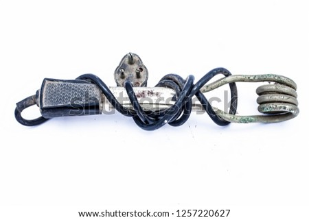 Close up of black handled immersion rod or immersion water heater isolated on white. #1257220627