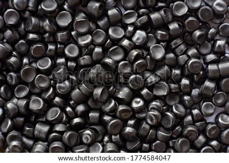 Close-up of black plastic polymer granules. polymer plastic. compound polymer. Stockfoto ©