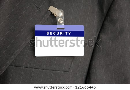 Close Up of Black Suit with Security ID Card