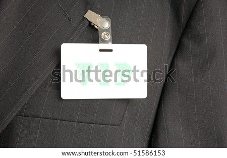 close up of black suit with VIP id card