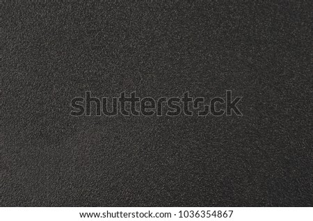 Close up of black textured plastic background #1036354867