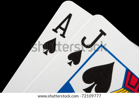Close-up of blackjack cards isolated on black
