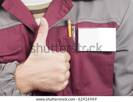 Close-up of blank name tag and service man uniform and thumbs up sign