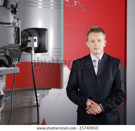 close up of blond middle age television news presenter in studio in front of the camera