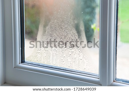 Close up of blown double glazed unit. Failed window glazing with condensation inside, UK