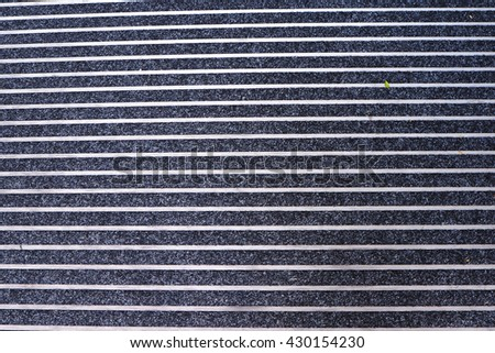 Close up of blue carpet with white strap #430154230