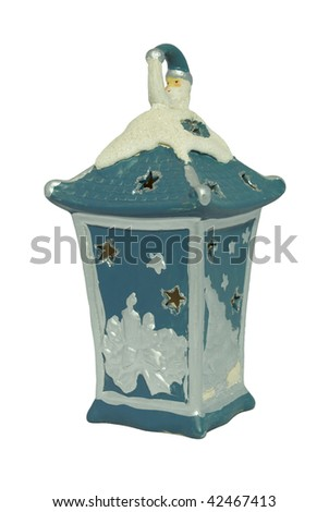 Close-up of blue ceramic candle lamp isolated on white background