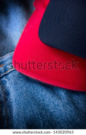 Close-up of blue jeans and hats.