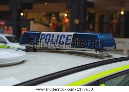 stock photo : Close up of blue lights on top of a UK police car.