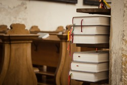 Close up of book stack in old church