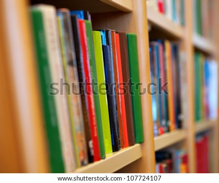 Close up of books in wooden book case - stock photo