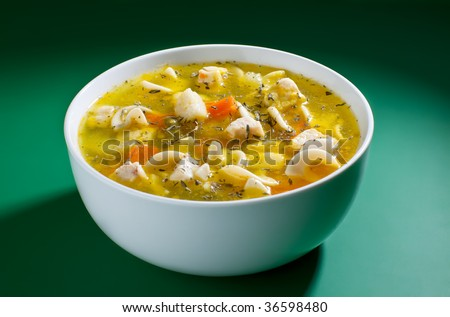 Close up of bowl of soup - stock photo