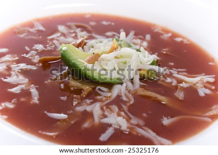 Close up of bowl of southwestern/mexican dish tortilla soup