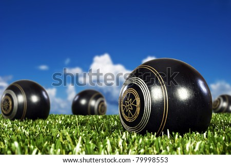 Close up of bowling balls on an open bowling field