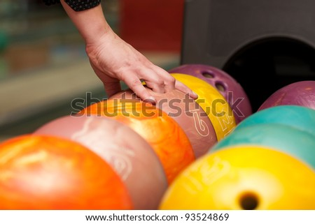 Close-up of bowling player hand taking ball