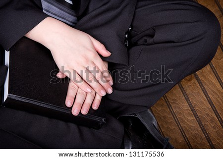 Close up of boy holding book wearing a suit