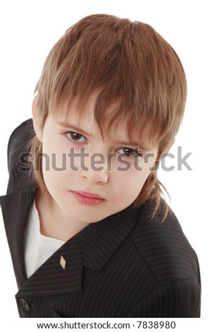 Close-up of boy in business suit. Shot in studio.