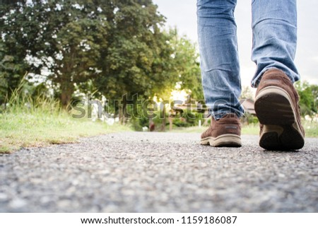 close up of boy shoes walking on the street in the evening #1159186087